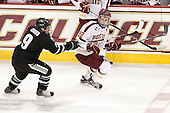 Damian Cross (PC - 9), Paul Carey (BC - 22) - The Boston College Eagles defeated the Providence College Friars 7-0 on Saturday, February 25, 2012, at Kelley Rink at Conte Forum in Chestnut Hill, Massachusetts.