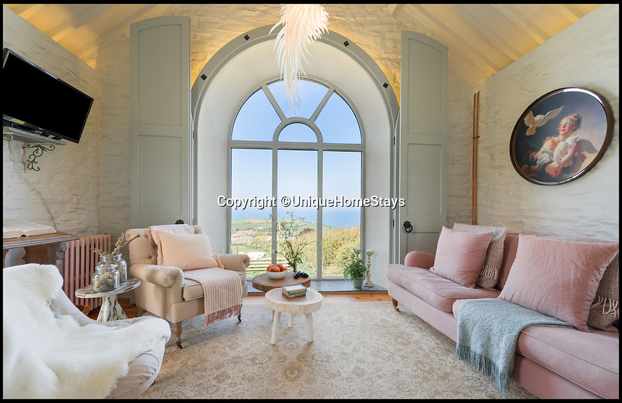 BNPS.co.uk (01202 558833)Pic: UniqueHomeStays/BNPS<br /> <br /> Praise the Lord...stunning former Chapel on the remote north coast of Cornwall is now a romantic bolthole.<br /> <br /> The former Methodist chapel on the historic Trevalga estate has now been turned into a heavenly holiday let with spectacular sea views can be rented for up to £2500 a week.<br /> <br /> The owners have given it a makeover with a nod to its ecclesiastical past, combining upcycled church pews and a lectern that compliment the arched and stained glass windows, alongside sumptuous furnishings and original artwork.<br /> <br /> As well as having stylish interiors, the quirky holiday home is perfectly placed - the historic Tintagel, linked to the legend of King Arthur, is to the left and the picturesque fishing port of Boscastle is to the right.