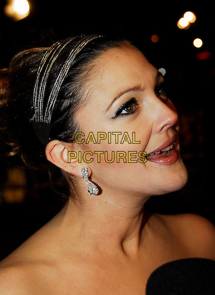 "DREW BARRYMORE.At the UK Film Premiere of ""Music & Lyrics"",.Odeon Leicester Square, London, England,.February 5th 2007..portrait headshot hairband hair band earrings profile.CAP/IA.©Ian Allis/Capital Pictures"