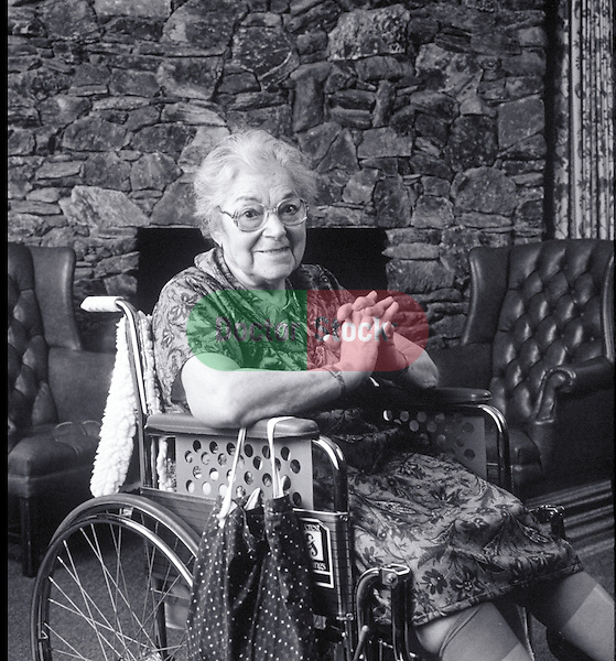 smiling elder woman in wheelchair