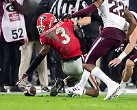 ATHENS, GA - NOVEMBER 23: Tyson Campbell #3 of the Georgia Bulldogs has an onside kick slip away from him ultimately recovered by Texas A