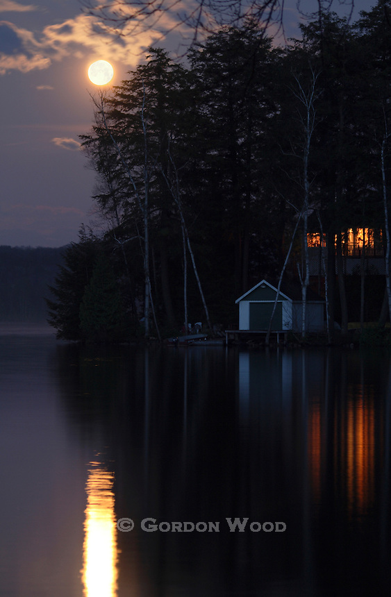 Cottage and Boat House under Full Moon on Lake in Haliburton Ontario Canada
