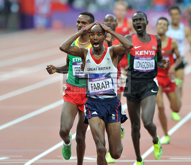 Mo Farah (GBR) wins the 5000m GOLD.Olympic Stadium.Olympic Park.Olympics 2012.London UK. .11/08/12,.photo: Sean Ryan / IPS Photo Agency.. mobile: 07971 400 939.Address: Thatched Cottage,Wretham,Thetford, Norfolk IP24 1RH .Office tel: 01953 499 403...