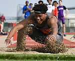 East St. Louis triple jumper Raymond Mix was all smiles as he touched down in the sand at the Norm Armstrong Boys Track and Field Invitational on Wednesday April 11, 2018. Mix won the event. Photo by Tim Vizer