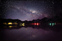 BNPS.co.uk (01202 558833).Pic: SamanthaCrimmin/BNPS..***Please Use Full Byline***..Milky Way reflected in Cumberland Bay in South Georgia...A British Doctors braved freezing conditions to capture unique pictures of the night sky from the tiny British island of South Georgia in the remote South Atlantic...Amateur photographer Samantha Crimmin's stunning photos of the sky at night over South Georgia have left locals so star-struck they have been turned into stamps...Dr Samantha Crimmin was working as an emergency medic for the British Antartic Survey team when she took the celestial images in her spare time...Dr Crimmin used long exposures and plenty of patience to create the incredible shots that show star trails in a perfect circular motion...Her gallery of photos depict the night sky above different locations on the tiny outpost in the south Atlantic...They include one above the Harker Glacier - named after British geologist Alfred Harker - and over the wrecks of two Norwegian whaling ships at Grytviken.