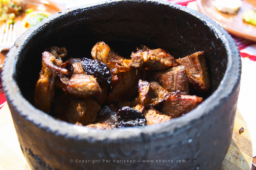 A traditional black earthenware pot called cereme used for cooking meat UNK Tradita traditional restaurant, Shkodra. Albania, Balkan, Europe.