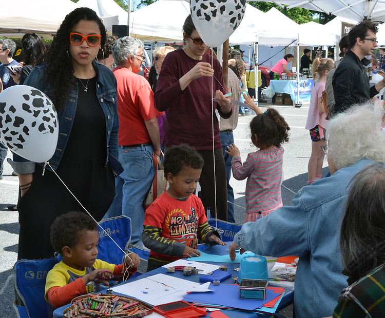 Children being entertained by, Anita Barbour, at the Craft Corner, at the Opening Day of the 2017 Saugerties Farmer's Market on Saturday, May 27, 2017. Photo by Jim Peppler. Copyright/Jim Peppler-2017.