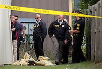 NWA Democrat-Gazette/JASON IVESTER <br /> Springdale Police investigate the scene on Wednesday, Aug. 19, 2015, after a report of shots fired behind the Autobuses Del Rio business on S. Thompson Street.