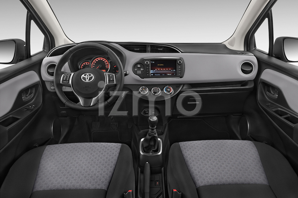 Stock photo of straight dashboard view of a 2015 Toyota YARIS Dynamic 5 Door Hatchback 2WD Dashboard