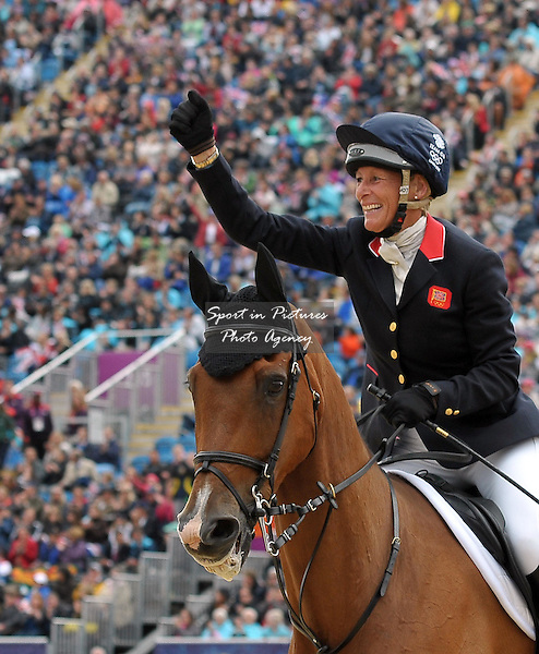 Mary King (GBR) punches the air in celebration. Equestrian Eventing - PHOTO: Mandatory by-line: Garry Bowden/SIP/Pinnacle - Photo Agency UK Tel: +44(0)1363 881025 - Mobile:0797 1270 681 - VAT Reg No: 768 6958 48 - 31/07/2012 - 2012 Olympics - Greenwich, London, England
