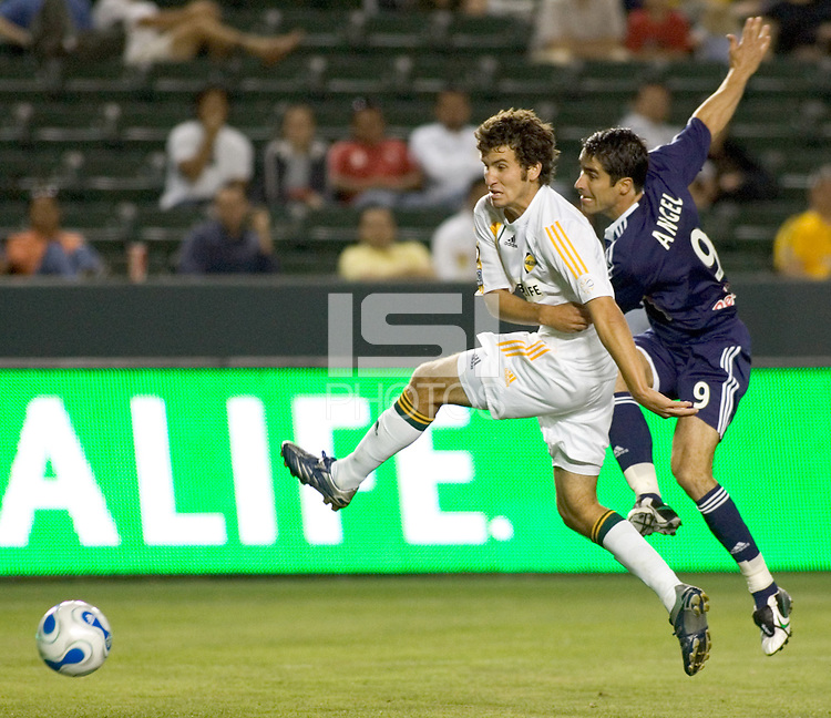 LA Galaxy DEF Nathan Sturgis (24) battles New York Red Bulls FWD Juan Pablo Angel (9) for a ball. The LA Galaxy defeated the New York Red Bulls 3-1 in OT during a US Open Cup qualifier at the Home Depot Center in Carson, California, May 8, 2007.