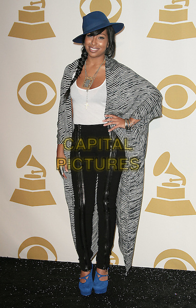 Melanie Fiona.The GRAMMY Nominations Concert Live held at the Nokia Theatre L.A. Live, Los Angeles, California, USA.  .November 30th, 2011.full length black leather trousers white top long grey gray cardigan blue shoes hat silver necklace hand on hip striped stripes.CAP/ADM.©AdMedia/Capital Pictures.