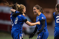 Seattle, WA - Saturday, May 14, 2016: Seattle Reign FC defender Lauren Barnes (3), midfielder Kim Little (8), and defender Kendall Fletcher (13) celebrate a goal. The Portland Thorns FC and the Seattle Reign FC played to a 1-1 tie during a regular season National Women's Soccer League (NWSL) match at Memorial Stadium.