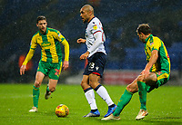 Bolton Wanderers' Josh Magennis takes on West Bromwich Albion's Craig Dawson<br /> <br /> Photographer Alex Dodd/CameraSport<br /> <br /> The EFL Sky Bet Championship - Bolton Wanderers v West Bromwich Albion - Monday 21st January 2019 - University of Bolton Stadium - Bolton<br /> <br /> World Copyright © 2019 CameraSport. All rights reserved. 43 Linden Ave. Countesthorpe. Leicester. England. LE8 5PG - Tel: +44 (0) 116 277 4147 - admin@camerasport.com - www.camerasport.com