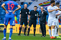 Referee Tony Harrington has a word with his assistants before taking action <br /> <br /> Photographer Alex Dodd/CameraSport<br /> <br /> The EFL Sky Bet Championship - Leeds United v Bolton Wanderers - Saturday 23rd February 2019 - Elland Road - Leeds<br /> <br /> World Copyright © 2019 CameraSport. All rights reserved. 43 Linden Ave. Countesthorpe. Leicester. England. LE8 5PG - Tel: +44 (0) 116 277 4147 - admin@camerasport.com - www.camerasport.com