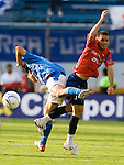 Cruz Azul fmidfielder Rogelio Chavez (L) fights for the ball against Veracruz Tiburones defender Lucas Ayala during their soccer match in the Azul Stadium in Mexico City, April 8, 2006. Cruz Azul won 3-0 to Veracruz... Photo by © Javier Rodriguez