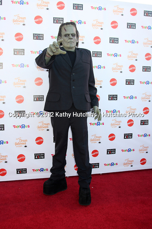 "LOS ANGELES - OCT 27:  Frankenstein Costume arrives at ""Keep A Child Alive Presents 2012 Dream Halloween Los Angeles"" at Barker Hanger on October 27, 2012 in Santa Monica, CA"