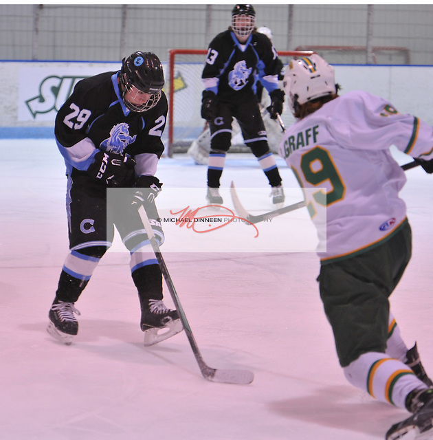 Chugiak defenseman Grant Epple blocks a shot by Service's Brady Graff.  Photo for the Star by Michael Dinneen