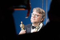 Guillermo del Toro poses backstage with the Oscar&reg; for achievement in directing and best picture for work on &ldquo;The Shape of Water&rdquo; during the live ABC Telecast of The 90th Oscars&reg; at the Dolby&reg; Theatre in Hollywood, CA on Sunday, March 4, 2018.<br /> *Editorial Use Only*<br /> CAP/PLF/AMPAS<br /> Supplied by Capital Pictures