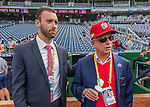 7 October 2016: MASN field reporter Dan Kolko (left) watches batting practice with Washington Nationals Owner Mark Lerner prior to the first game of the NLDS against the Los Angeles Dodgers at Nationals Park in Washington, DC. The Dodgers edged out the Nationals 4-3 to take the opening game of their best-of-five series. Mandatory Credit: Ed Wolfstein Photo *** RAW (NEF) Image File Available ***