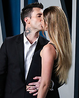 BEVERLY HILLS, LOS ANGELES, CALIFORNIA, USA - FEBRUARY 09: Adam Levine and Behati Prinsloo arrive at the 2020 Vanity Fair Oscar Party held at the Wallis Annenberg Center for the Performing Arts on February 9, 2020 in Beverly Hills, Los Angeles, California, United States. (Photo by Xavier Collin/PictureGroup)