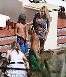 9-8-09  Exclusive..Pamela Anderson swimming & laying out in a bikini with her kids at the Four Seasons Hotel in Santa Barbra California. It looks like Pamela got herself a new dog. ...AbilityFilms@yahoo.com.805-427-3519.www.AbilityFilms.com.