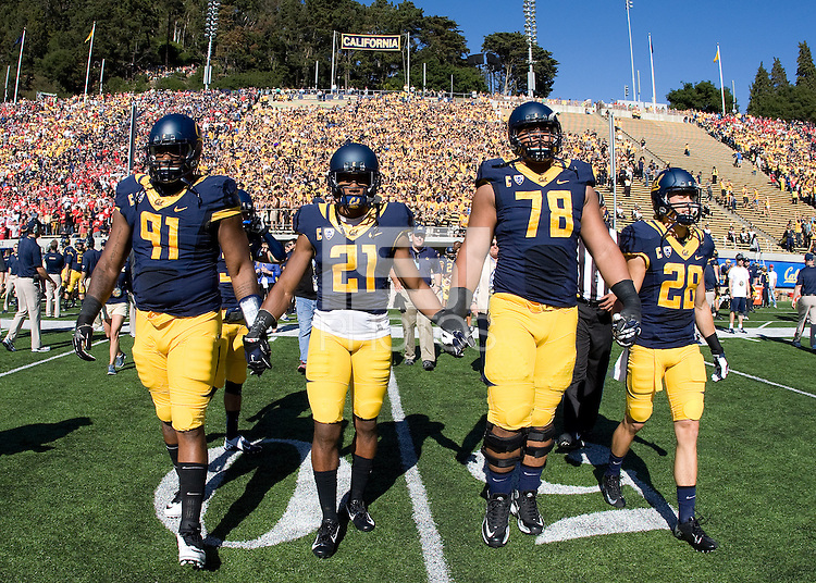 California captains' Deandre Coleman, Stefan McClure, Freddie Tagaloa and Jackson Bouza walk on the field for coin toss before the game against Ohio State at Memorial Stadium in Berkeley, California on September 14th, 2013.  Ohio State defeated California, 52-34.