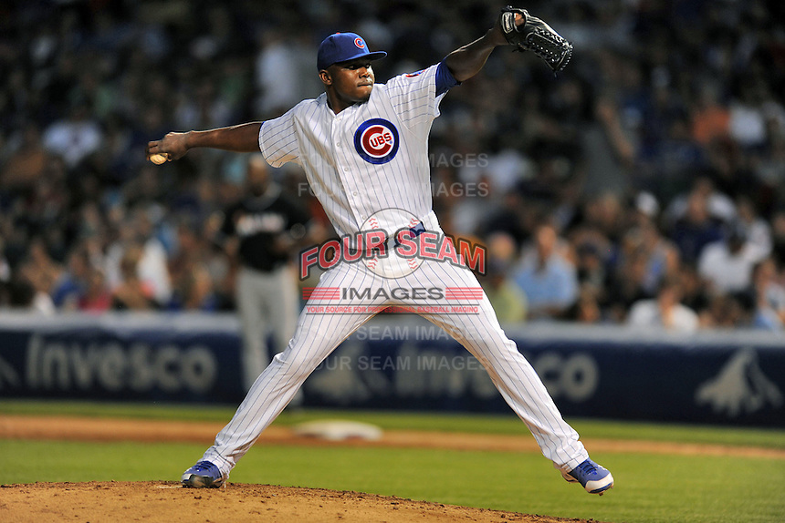Chicago Cubs pitcher Rafael Dolis #48 delivers a pitch during a game against the Miami Marlins at Wrigley Field on July 17, 2012 in Chicago, Illinois. The Marlins defeated the Cubs 9-5. (Tony Farlow/Four Seam Images).