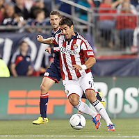 Chivas USA substitute forward Juan Pablo Angel (9) brings the ball forward. In a Major League Soccer (MLS) match, the New England Revolution tied Chivas USA, 3-3, at Gillette Stadium on August 29, 2012.
