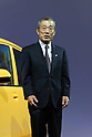 Honda Motor President Takeo Fukui poses with the new Life compact car. The standard models will be released on Friday and special mobility-assist model for handicapped users on Dec 5. The price range will be 945,000 yen to 1,680,000 yen.