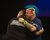 01.01.2014.  London, England.  William Hill PDC World Darts Championship.  Quarter Final Round.  Peter Wright (5) [SCO] congratulates Gary Anderson (4) [SCO] after the winning double in their match.  Anderson won the match 5-1