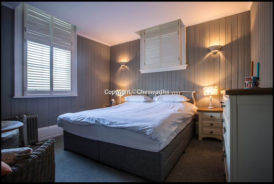 BNPS.co.uk (01202 558833)<br /> Pic: Chesworths/BNPS<br /> <br /> One of the bedrooms in the station house.<br /> <br /> An ornate 19th century railway station built just so the then Prince of Wales could go on weekend jaunts to the races has gone on sale for £1.5 million. <br /> <br /> It is 50 years since the last train departed from Petworth Railway Station, which has since been converted into an 11-bed luxury bed and breakfast. <br /> <br /> And this is because almost nobody other than the future King Edward VII had any call to use it.