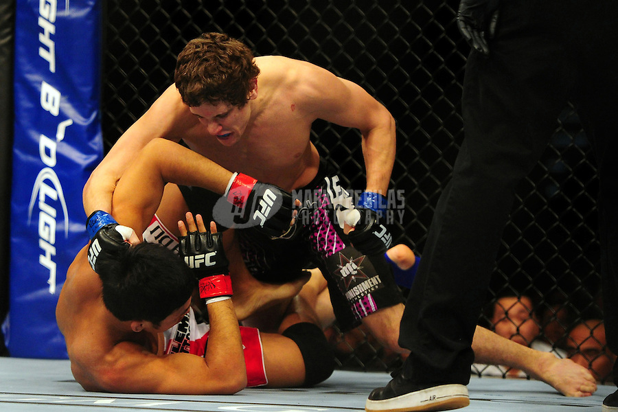 Dec 30, 2011; Las Vegas, NV, USA; UFC fighter Nam Phan (bottom) fights against Jimy Hettes (top) during a featherweight bout at UFC 141 at the MGM Grand Garden event center. Mandatory Credit: Mark J. Rebilas-