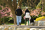 Seward Park, Seattle Parks and Recreation. Couple walking dog in park
