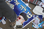 """A poster of Rabbi Ovadia Yossef, the ultra orthodox """"Shas"""" party's spiritual leader, on the ground outside of a polling station in Sderot, Tuesday, February 10, 2009. The southern Israeli city of Sderot has become the symbol of the home front towns that have been under constant rocket attacks from Gaza, and Israeli politicians have been frequenting the town during their election campaigns..Eliahu Ben Igal / JINI"""