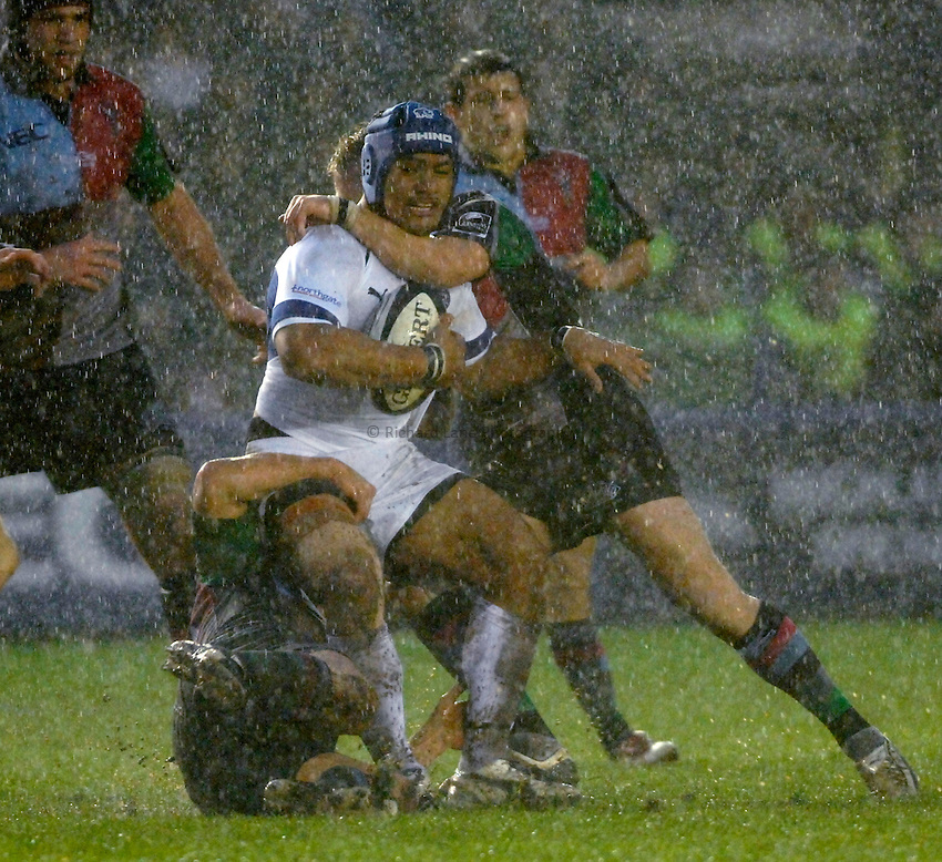 Photo: Richard Lane..NEC Harlequins v Bath Rugby. Guinness Premiership. 06/01/2007. .Bath's Eliota Fuimaono-Sapolu is tackled in the rain.