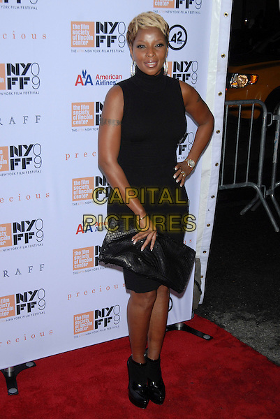 "MARY J. BLIGE.At the 47th Annual New York Film Festival Centerpiece Screening of ""Precious"" held at Alice Tully Hall, Lincoln Center, New York, NY, USA, October 3rd, 2009. .full length black polo neck sleeveless dress clutch bag hand on hip ankle boots tattoo patent .CAP/LNC/TOM.©LNC/Capital Pictures"