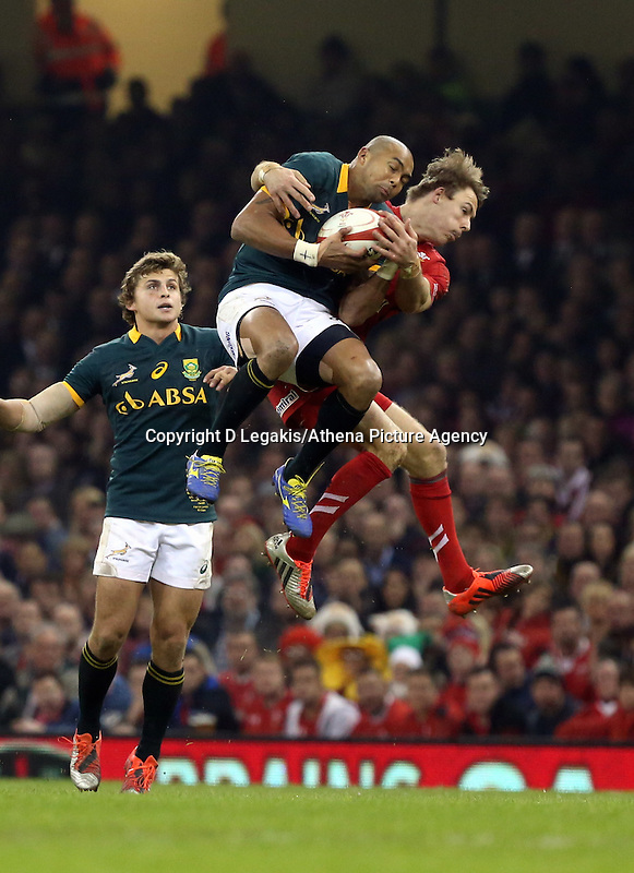Pictured: Liam Williams of Wales (R) clashing mid-air against Cornal Hendricks of South Africa (L) Saturday 29 November 2014<br /> Re: Dove Men Series 2014 rugby, Wales v South Africa at the Millennium Stadium, Cardiff, south Wales, UK.