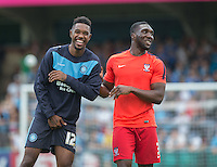 Jason Banton of Wycombe Wanderers and Femi Ilesanmi of York City are all smiles before kick off during the Sky Bet League 2 match between Wycombe Wanderers and York City at Adams Park, High Wycombe, England on 8 August 2015. Photo by Andy Rowland.
