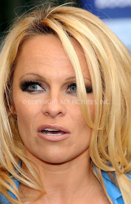 WWW.ACEPIXS.COM . . . . .  ..... . . . . US SALES ONLY . . . . .....October 24 2010, London....Pamela Anderson at a photocall for PETA at the London Transport Museum on October 24 2010 in London....Please byline: FAMOUS-ACE PICTURES... . . . .  ....Ace Pictures, Inc:  ..Tel: (212) 243-8787..e-mail: info@acepixs.com..web: http://www.acepixs.com