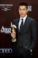 "HONG KONG - MARCH 21:  Taiwan actor Mark Chao Yu-Ting poses backstage after winning the Best Newcomer Award for his role at the ""Monga"" during the 5th Asia Film Awards ceremony at the Convention and Exhibition Centre on March 21, 2011 in Hong Kong, China.  Photo by Victor Fraile / studioEAST"