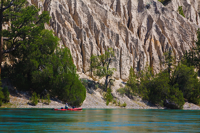 A kayaker enjoying the calm waters and scenery along the Flathead River in Montana