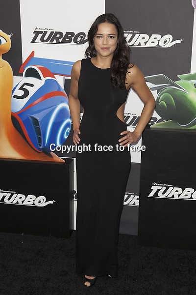 NEW YORK, NY - JULY 9: Michelle Rodriguez attends the 'Turbo' premiere at AMC Loews Lincoln Square on July 9, 2013 in New York City.<br />