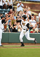 Jacksonville Suns first baseman Viosergy Rosa (44) high fives coach Rich Arena (14) after hitting a three run home run in the bottom of the first inning during game three of the Southern League Championship Series against the Chattanooga Lookouts on September 12, 2014 at Bragan Field in Jacksonville, Florida.  Rosa was named the series Most Valuable Player as Jacksonville defeated Chattanooga 6-1 to sweep three games to none.  (Mike Janes/Four Seam Images)