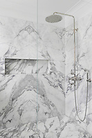 Panels of marble have been carefully arranged in symmetry on the walls of this shower