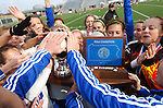 Warrior Run High School girls soccer team mates want to touch the trophy after winning the 2010 PIAA Class AA championship.