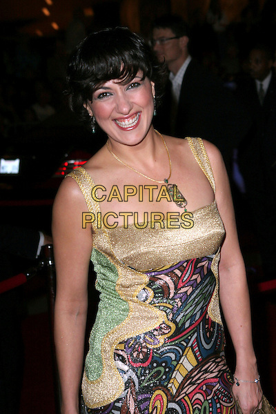 MELTEM CAMBUL.17th Annual Palm Springs International Film Festival Gala Awards Presentation - Arrivals held at the Palm Springs Convention Center, Palm Springs, California.  .January 7th, 2006.Photo: Zach Lipp/AdMedia/Capital Pictures.Ref: ZL/ADM.half length necklace gold dress print.www.capitalpictures.com.sales@capitalpictures.com.© Capital Pictures.