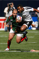 February 14 2009, San Diego, CA, USA:  The IRB USA Sevens Tournament at Petco Park in Downtown San Diego.  A Fiji player gets airborne as he tries to evade a tackle by a Mexico player during day one action.