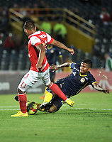 BOGOTA- COLOMBIA -16 -04-2014: Wilder Medina (Izq.) jugador de Independiente Santa Fe disputa el balón con Harold Macias (Der) jugador de Universidad Autonoma durante partido aplazado entre Independiente Santa Fe y Universidad Autonoma por la fecha 16 entre de la Liga Postobon I 2014, jugado en el estadio Nemesio Camacho El Campin de la ciudad de Bogota. / Wilder Medina (L) player of Independiente Santa Fe vies for the ball with Harold Macias (R) player of Universidad Autonoma during a postponed match between Independiente Santa Fe and Universidad Autonoma for the date 16th of the Liga Postobon I 2014 at the Nemesio Camacho El Campin Stadium in Bogota city. Photo: VizzorImage  / Luis Ramirez / Staff.