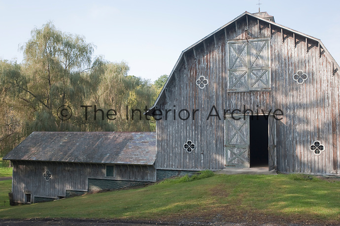 Double doors open into a cathedral-like hay loft which adjoins a low stable block